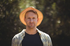 Handsome young man wearing hat on sunny day at olive farm Royalty Free Stock Photography