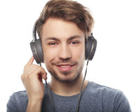 Handsome young man wearing headphones and listening to music. Stock Photography