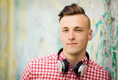 Handsome young man wearing headphones Royalty Free Stock Photography