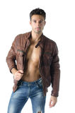 Handsome young man wearing leather jacket on naked torso royalty free stock images