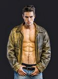Handsome young man wearing leather jacket on naked Stock Photos
