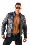 Handsome young man wearing leather jacket on naked torso, isolated Stock Photo