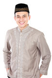 Handsome young man wearing muslim dress. Posing on white background Royalty Free Stock Photo