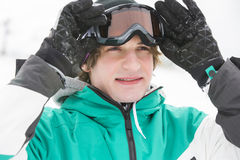 Handsome young man wearing ski goggles outdoors Royalty Free Stock Images