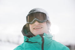 Handsome young man wearing ski goggles outdoors Royalty Free Stock Image