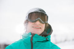 Handsome young man wearing ski goggles outdoors Royalty Free Stock Photos
