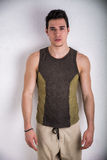 Handsome young man wearing stylish sleeveless Stock Images