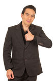 Handsome young man wearing a suit posing with Stock Images