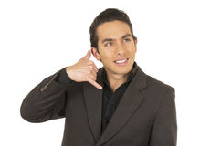 Handsome young man wearing a suit posing gesturing Stock Photography