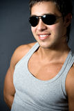 Handsome young man wearing sunglasses Stock Image