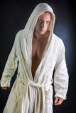 Handsome young man wearing white bathrobe Stock Photography