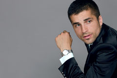 Handsome young man wears a watch Stock Photos