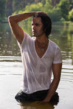 Handsome young man in wet clothes Stock Photography
