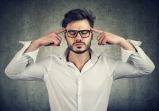Concentrated man with eyes closed Stock Photo