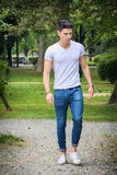 Handsome young man in white t-shirt outdoor in Stock Photography