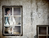 Handsome Young Man in a Window Stock Photography