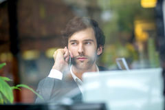 A handsome young man in the window Royalty Free Stock Photo