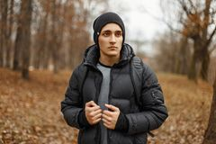 Handsome young man in winter clothes with a backpack Royalty Free Stock Photography