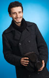 Handsome young man in winter clothing Stock Photos