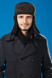 Handsome young man in winter clothing Royalty Free Stock Image