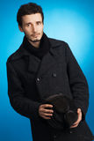 Handsome young man in winter clothing Stock Images