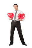 Handsome young man wit red hearts Royalty Free Stock Image