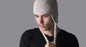 Handsome young man with wool hat Royalty Free Stock Images
