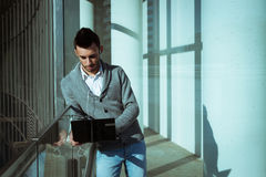 Handsome young man working at computer and listening to music. Outdoor Royalty Free Stock Images