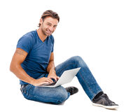 A handsome young man working on his laptop Royalty Free Stock Photos