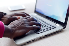 Handsome young man working with his laptop at home. Stock Photography