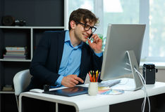 Handsome young man working from home office. Modern business concept Royalty Free Stock Image