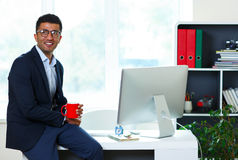 Handsome young man working from home office Royalty Free Stock Image