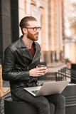 Handsome young man working on laptop. Outdoors Royalty Free Stock Images