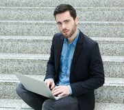 Handsome young man working on laptop Royalty Free Stock Photos