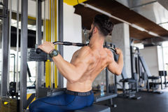 Handsome young man working on lat machine Royalty Free Stock Image