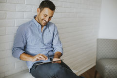 Handsome young man working with tablet Royalty Free Stock Photography