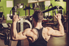 Handsome young man workout in fitness gym Stock Image