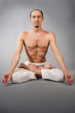 Handsome young man in yoga position Royalty Free Stock Image