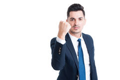 Handsome young manager threatening by showing the fist. Handsome and aggresive young manager threatening by showing the fist isolated on white background Stock Photo