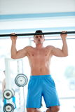 Handsome young mand working out in gym Stock Photo