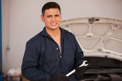 Handsome young mechanic at work Royalty Free Stock Photography