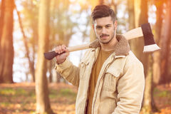Handsome young men with axe Stock Photos