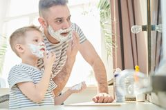 Having Fun with Dad at Bathroom stock photography