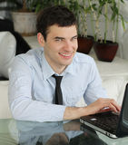 Handsome young men with laptop in public space. Portrait of Handsome young men with laptop in public space. businessman smile a happy smile Stock Photography