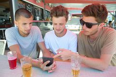 Handsome young men making selfie in cafe outdoors Royalty Free Stock Photo