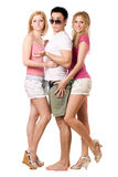 Handsome young man and two attractive girls Stock Photo