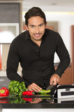 Handsome young modern man cooking healthy recipe Stock Photography