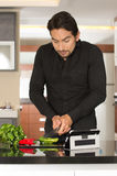 Handsome young modern man cooking healthy recipe Royalty Free Stock Images