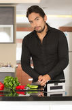 Handsome young modern man cooking healthy recipe Stock Photo