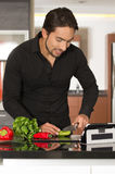 Handsome young modern man cooking healthy recipe Royalty Free Stock Photo